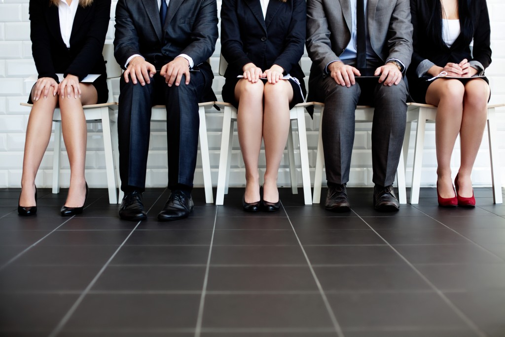 stressed business people waiting in lobby for job interview